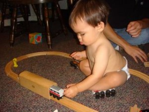 Last but not least, my mom took out Brett G's old Thomas the Train trains and tracks.  Noby loved pushing the train cars through the tunnel.