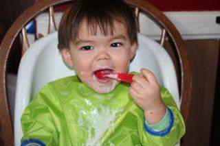 Eating yogurt all by himself!