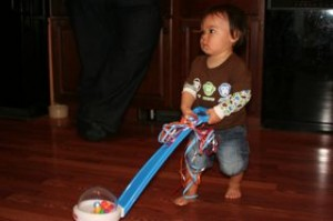 We also helped him open his gifts.  Here he's trying out this popper.