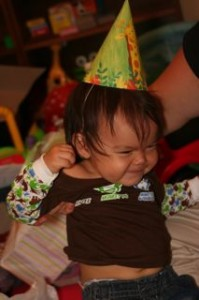 Later that night we had Noby try on his birthday hat.  He didnt really like them! haha