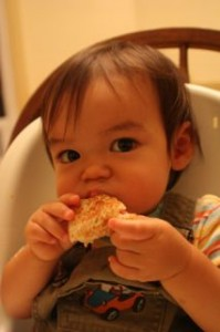 Enjoying his grilled cheese.