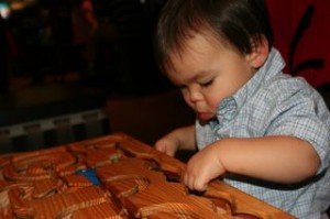 Noby playing with his puzzle at the museum.