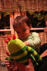 Noby checking out his monster.  Check it out we put him in his green striped pjs, just like this monster!