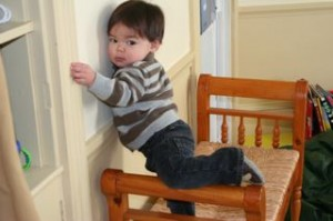 Before we installed the new storage units in the playroom, Noby would climb on the bench and put his legs over the sides.  Only fell twice!!!!