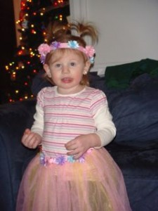 Avery showing off the tutu and crown we got her.  Love the tongue sticking out!!